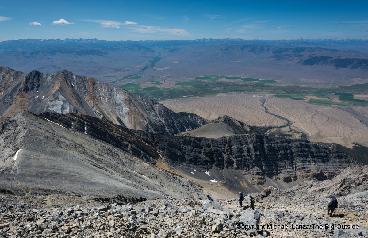 Hikers descending off the summit of Idaho's 12,662-foot Borah Peak.