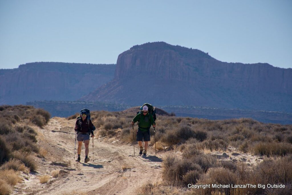 Backpackers on a 4WD road in the Maze District, Canyonlands National Park.