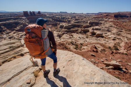 A backpacker at Maze Overlook in the Maze District, Canyonlands National Park.