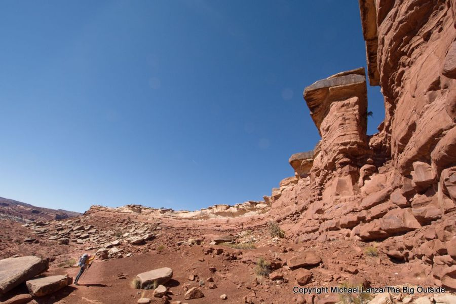 A backpacker descending the trail off Maze Overlook in the Maze District, Canyonlands National Park.