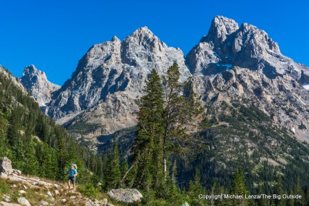 A backpacker on the Teton Crest Trail, North Fork Cascade Canyon, Grand Teton National Park.