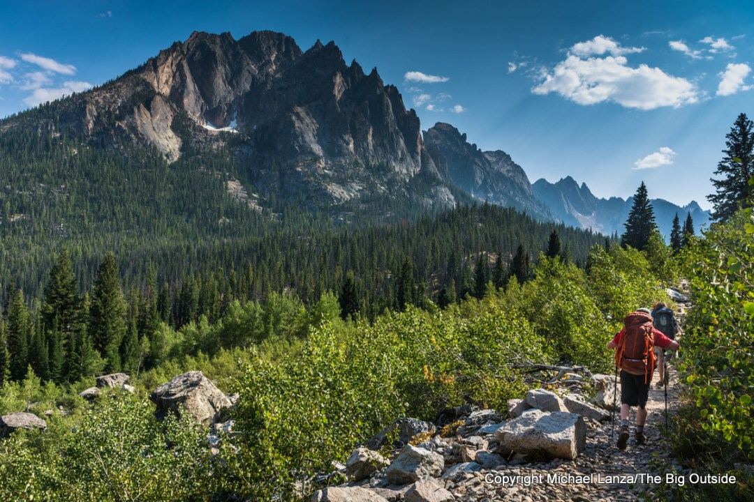 Backpackers hiking up Trail 101 in the Redfish Creek Valley, Sawtooth Mountains, Idaho.