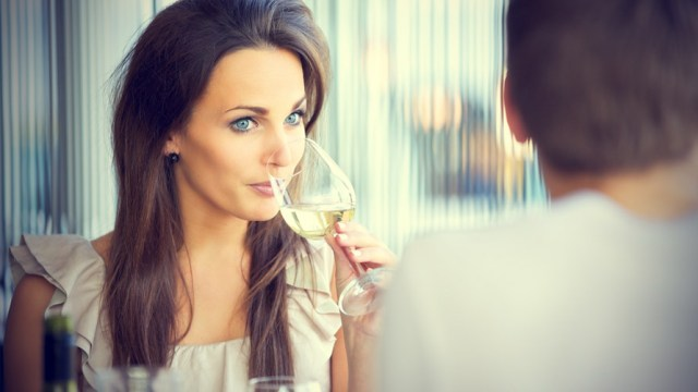 girl-drinking-her-wine-and-watching-her-guy