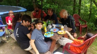 Eating together after some house construction in Marshall, N.C.