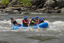 Rafting down the French Broad River.
