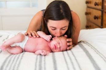 newmom kissing baby
