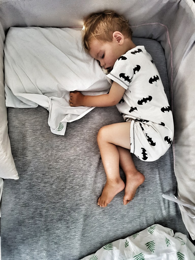 toddler sleeping in bed