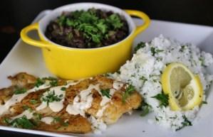 Blackened Tilapia with lemony crema sauce with black beans and cilantro rice