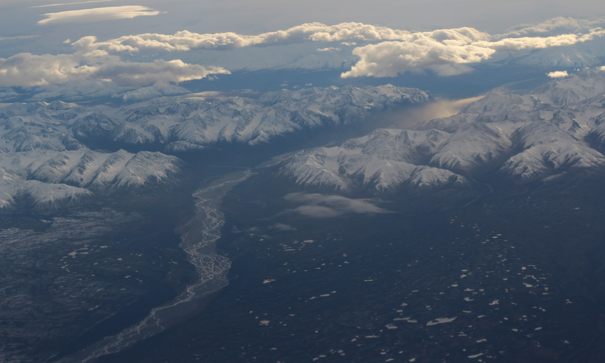 River, mountains, and cloud as seen from the plane