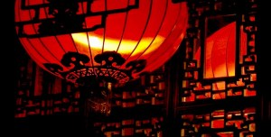 Red Chinese lanterns against a wood latice