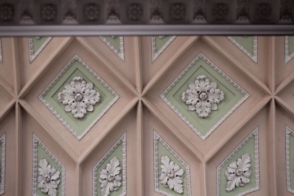 ornate church ceiling with diamond shapes and flowers