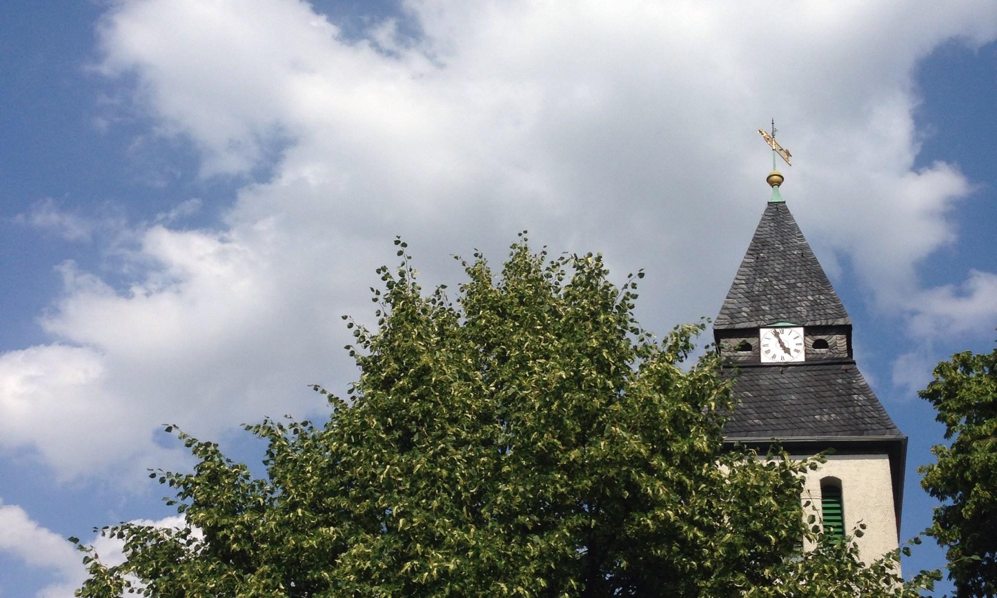 church behind a tree