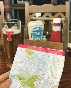 Photo of a map of Glasgow next to a pint of beer