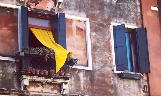 photo of a yellow curtain in a window