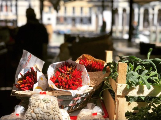 Photo of bouquets of dried chilies wrapped in white paper