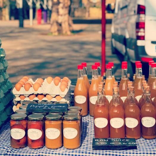 Photo of eggs, preserves, and bottled goods at a farmers market