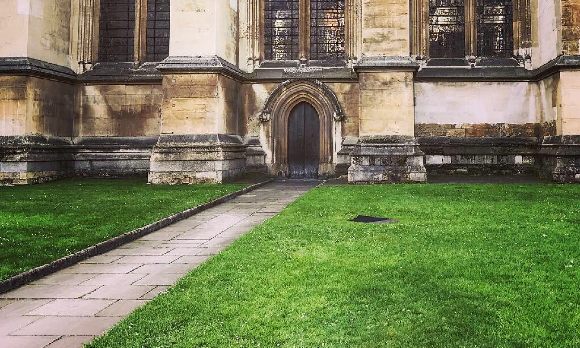 Photo of lawn and doorway into Westminister Abbey