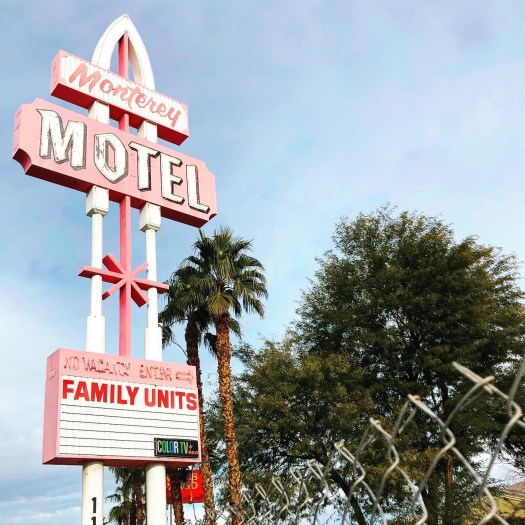 Photo of an old pink and white motel sign