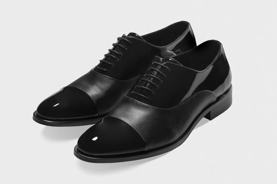Cap toe leather tuxedo shoes.