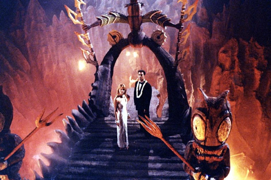Tom Hanks prepares to sacrifice Meg Ryan after their wedding in Joe vs. The Volcano.