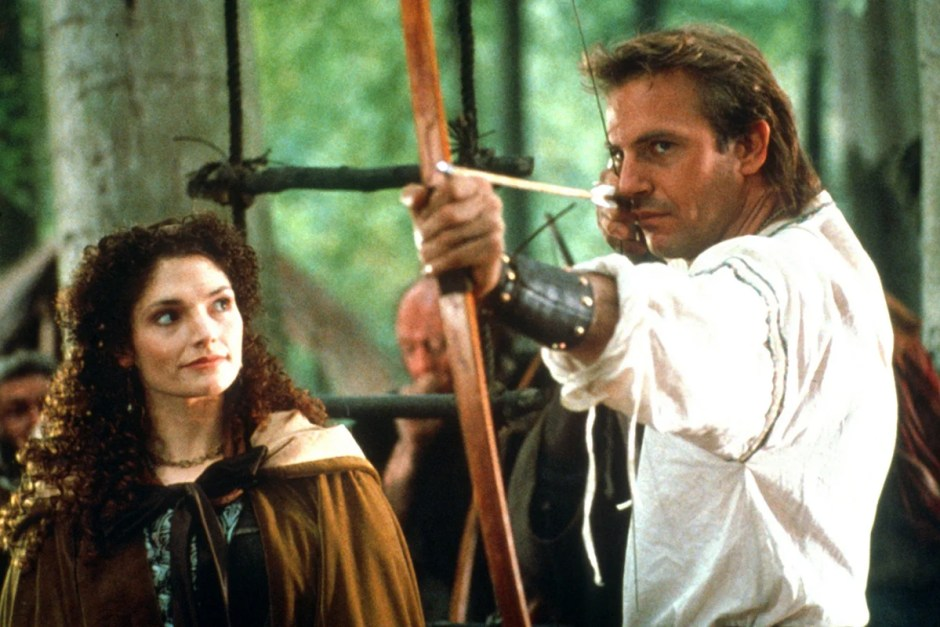 Kevin Coster impresses Maid Marian with a bow in Robin Hood.
