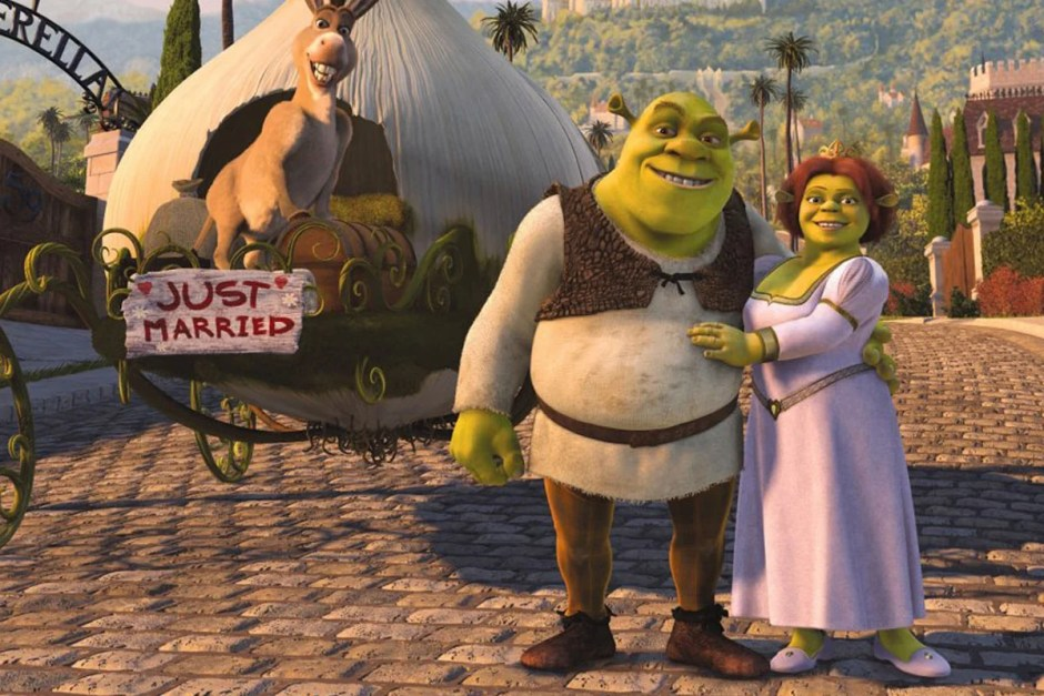 Shrek, Donkey, and Fiona near the getaway carriage.
