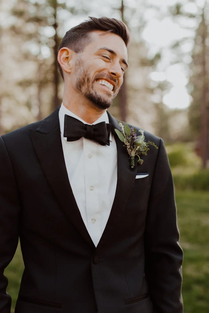 man laughing about tuxedo rental cost