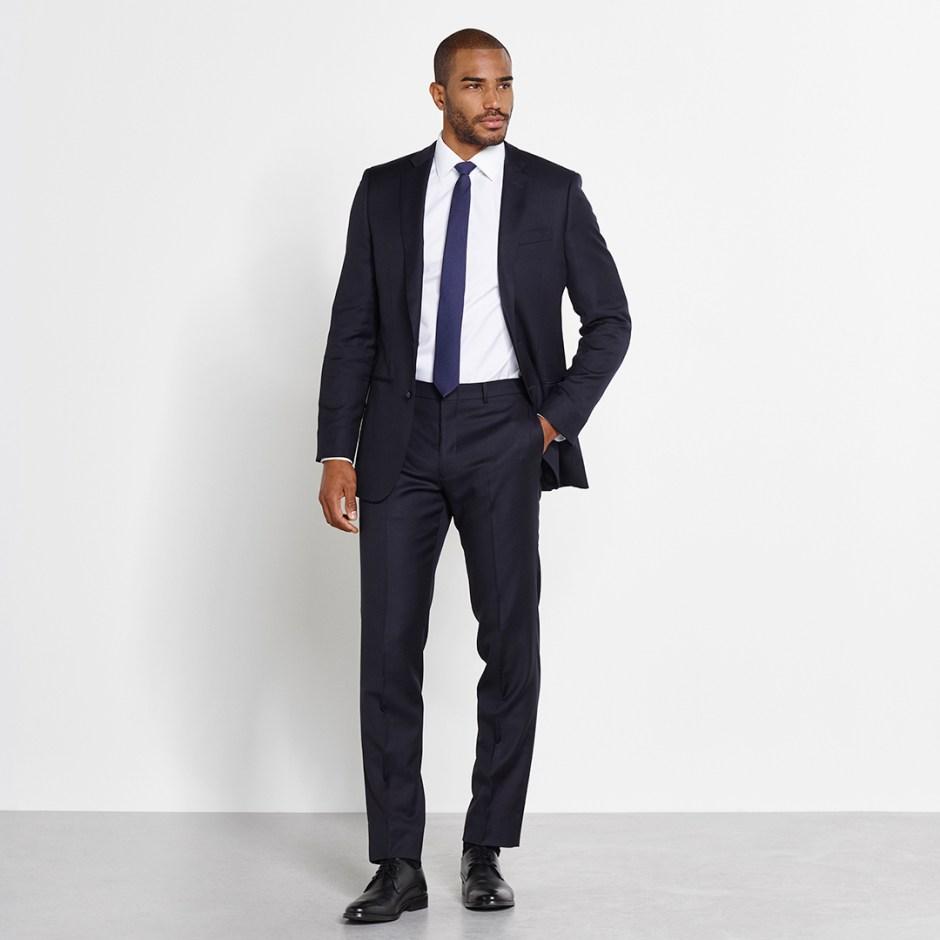 man wearing navy groom suits