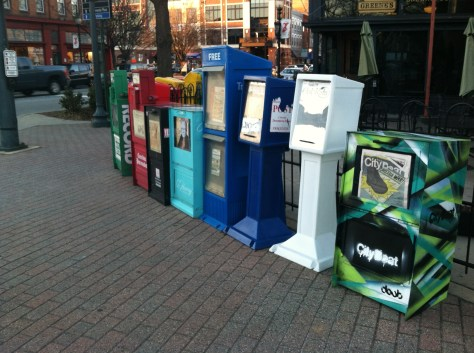 Newspaper Dispensers in Downtown Greensboro. Photo By Kristen E. Jeffers