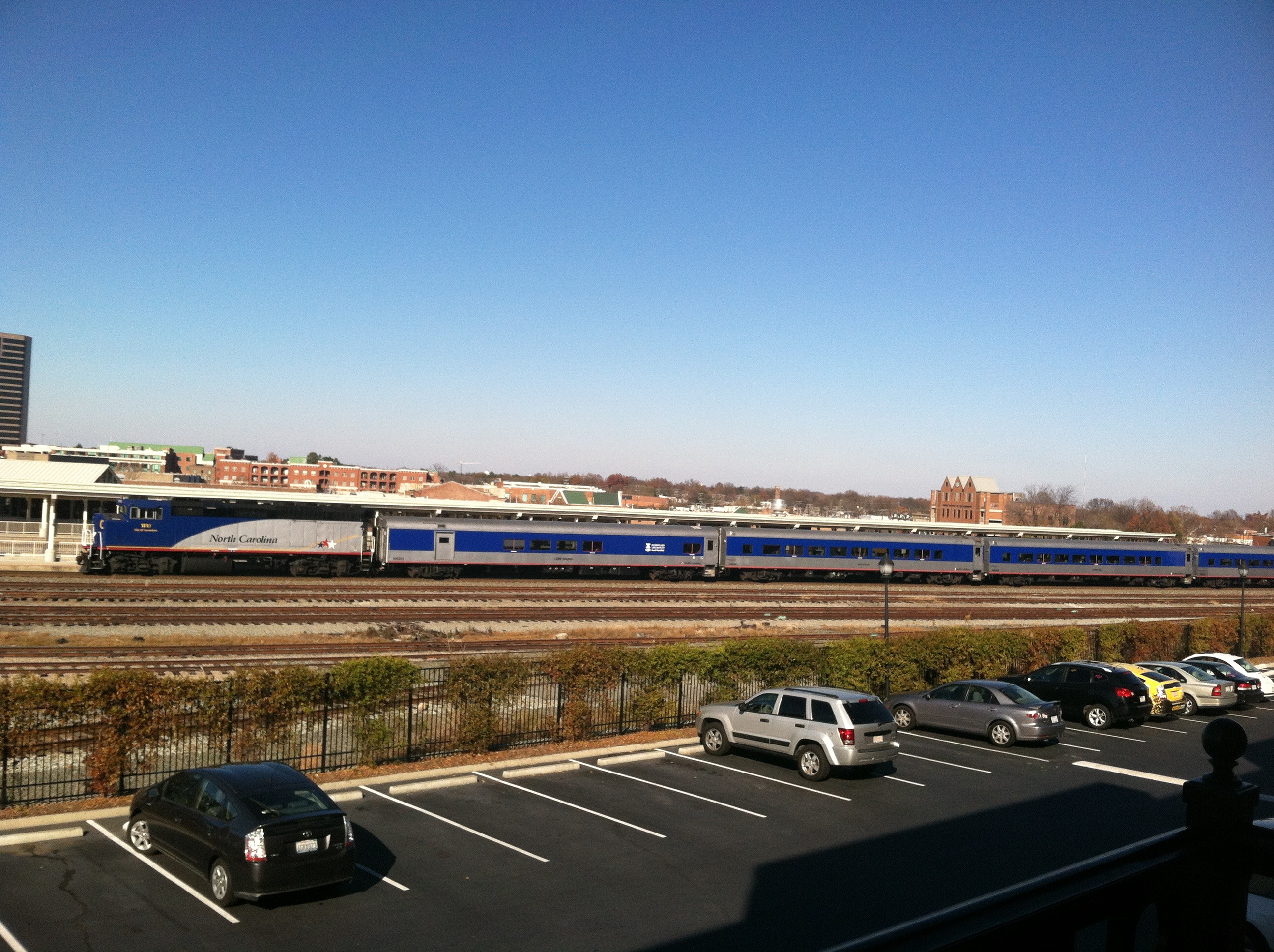 Mid-Day Piedmont train in route to Charlotte from Raleigh, as seen from the balcony of CityView Apartments in Greensboro. Photo by Kristen Jeffers, the author.