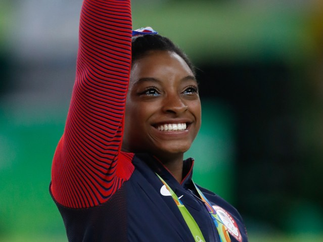 Simone_Biles_at_the_2016_Olympics_all-around_gold_medal_podium_(28262782114)_cropped