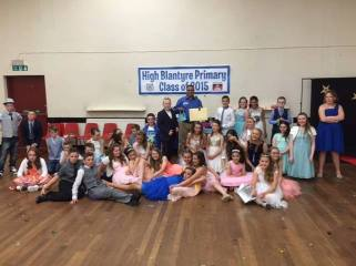 2015 P7 pupils at their prom in Cemetery Hall with Mo Razzaq