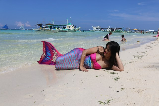 mermaid sunbathing