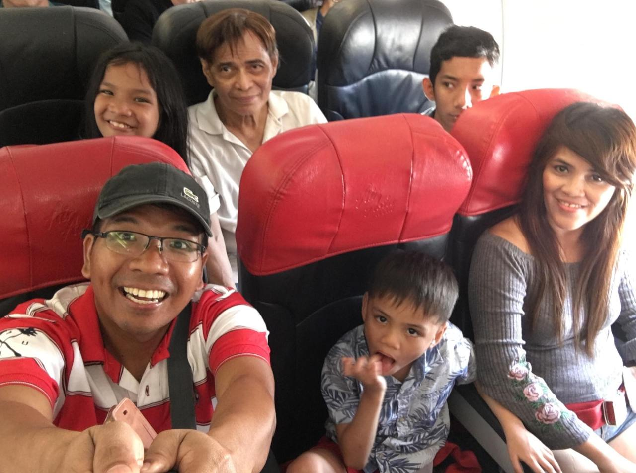 in the plane back to Manila