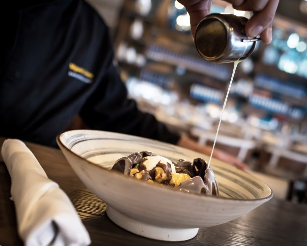 Miami Restaurant, Pisco y Nazca serves this crazy Chocolate Dome dessert that they melt with warm white chocolate sauce to reveal vanilla ice cream, candied chocolate, and caramel popcorn inside. Amazing! Click to read about their other dishes on the menu or pin to save for later!