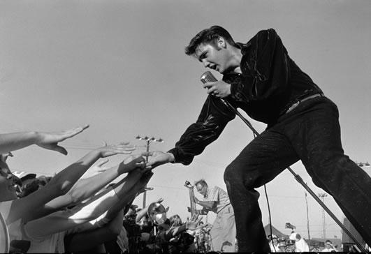 ∫ Roger Marshutz, (1929-2007) Elvis Presley in Tupelo, Mississippi, 1956. Gelatin Silver Print ( From Marshutz.com)
