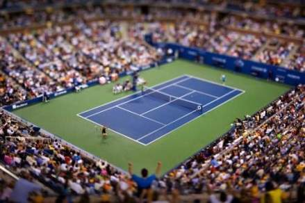 I was using a 45mm tilt-shift lens, which allowed me to produce something aesthetically different. It shows Sharapova in focus and her opponent, Justine Henin, out of focus. The image tells the story of her victory from the context of the thousands of people who had witnessed the moment. This perspective gives you an appreciation for the scale of the event that you don't necessarily get with a long telephoto lens, where the background is completely blurred out.