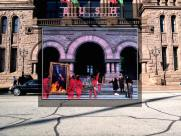 """Location: The Ontario Legislative Building, Queens Park, Toronto, Canada. . . Photo by Deborah Samuel; art direction by Hugh Syme. . .The album was their 8th studio album and featured the hit """"Tom Sawyer."""" According to Wikipedia: """"The album cover art is a visual pun on the title, and a triple entendre. The first meaning is represented by the movers carrying pictures, with the second by the people watching them who are emotionally moved by the pictures. The third meaning is shown on the back cover, where the entire scene is revealed to be a set for a motion picture."""" (Thanks to Rafi Ghanaghounian of Toronto for the background picture.) © Bob Egan"""