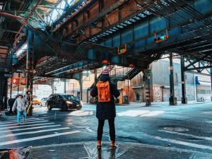 Man standing underneath the bridge in Brooklyn.