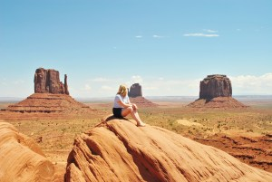 sitting girl at monument valley