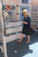 Browsing the local crafts in Oia.