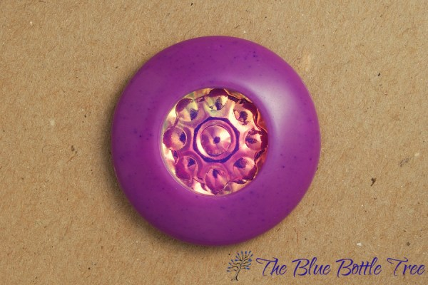 Pendant made from polymer clay in a hollow design with a holographic image deep inside.