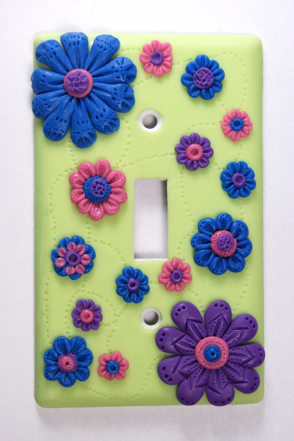 Glow in the Dark Switch plate sculpted with polymer clay.