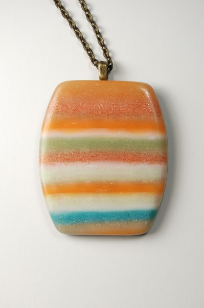 Orange striped polymer clay pendant made from DesignDiva1's Controlled Marbling Tutorial