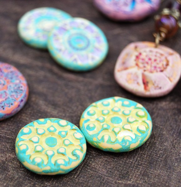 Rustic Beads treated with a distressed antique treatment in yellow and turquoise.
