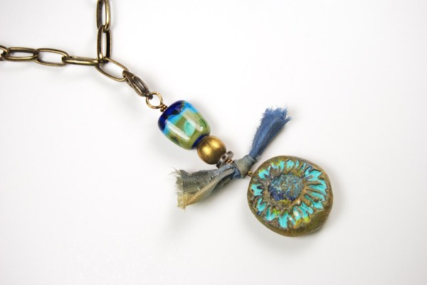 Necklace featuring a Rustic Focal bead by The Blue Bottle Tree and a glass accent bead by Numinosity Beads.