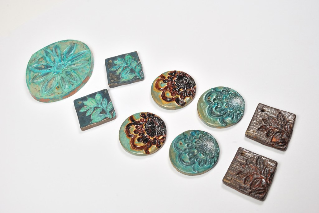Polymer clay charms colored with VerDay Paint and Patina by The Blue Bottle Tree.