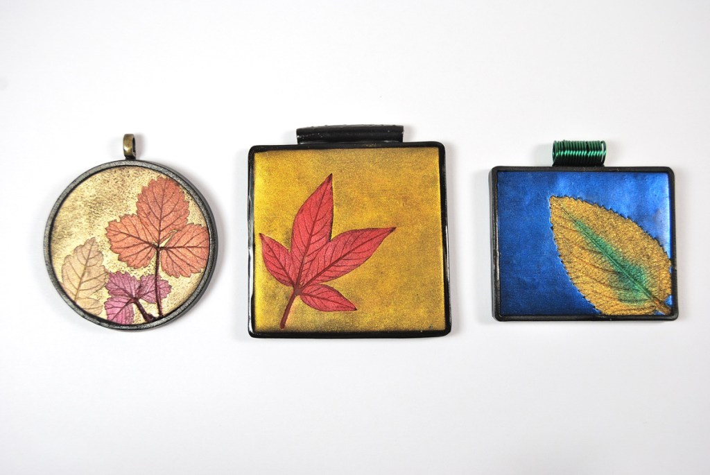 Learn to make these colorful Mica Leaf Pendants with the free tutorial by The Blue Bottle Tree
