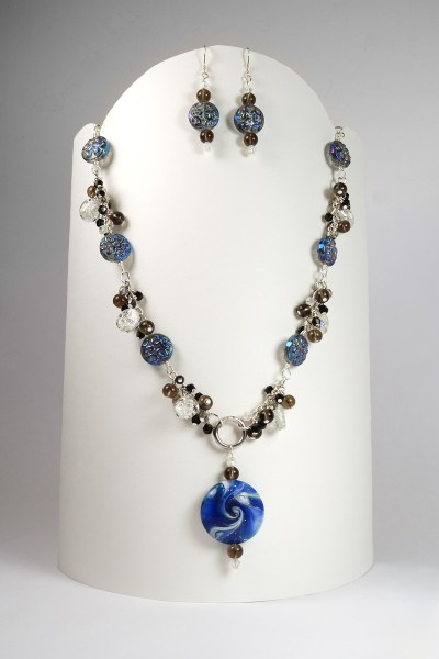 My contribution to the 6th Do Over Challenge using Jeannie K Dukic's beads combined with my own.