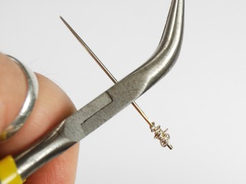 Wrap the eye of the needle with craft wire.